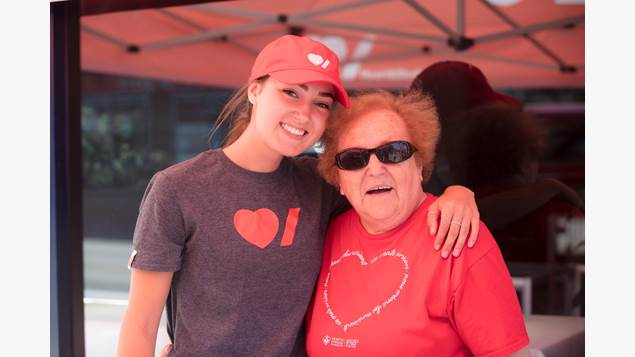 Two Heart & Stroke Big Bike volunteers with their arms around each