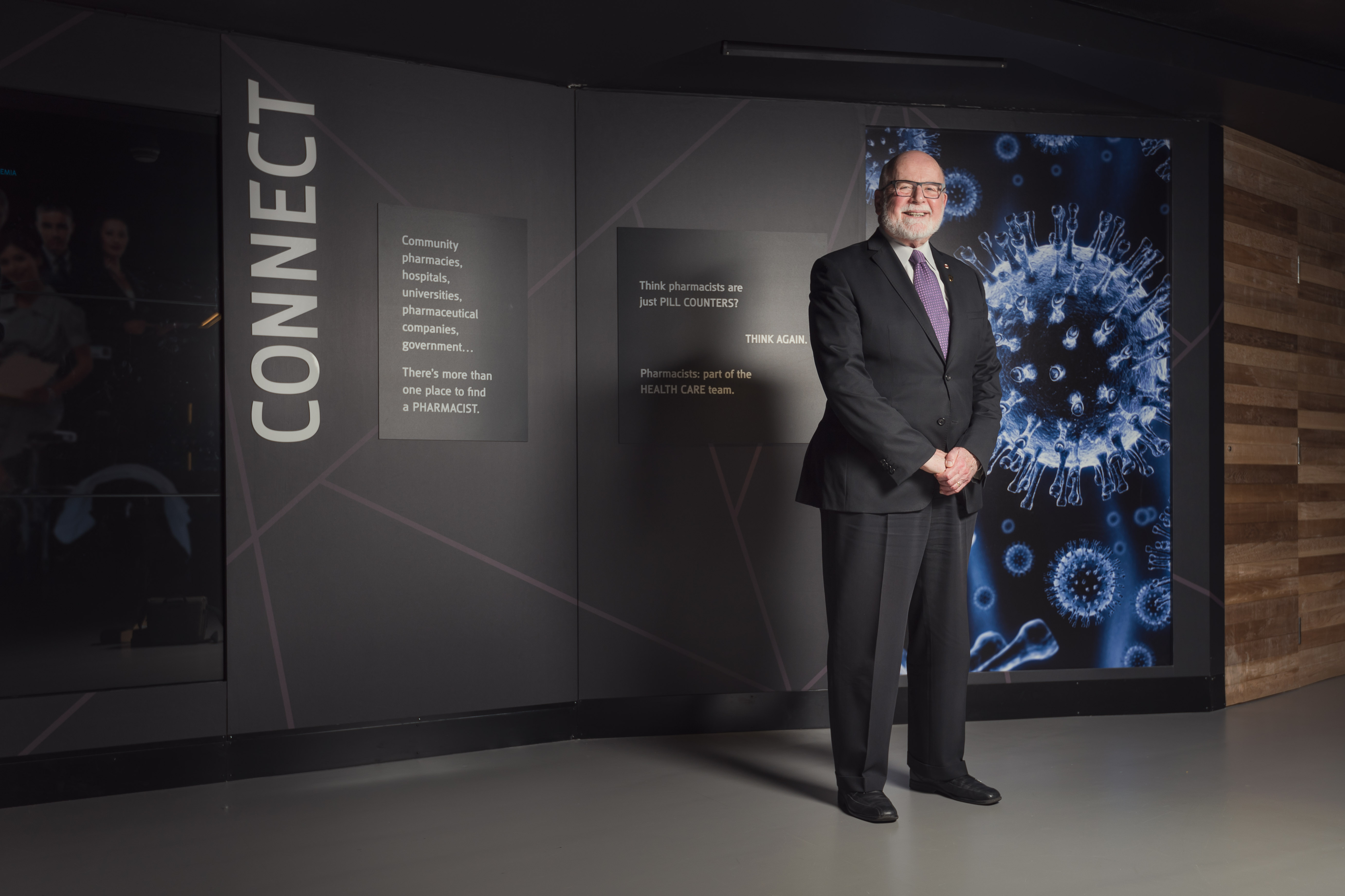 Dr. John McNeill stands in front of a display.