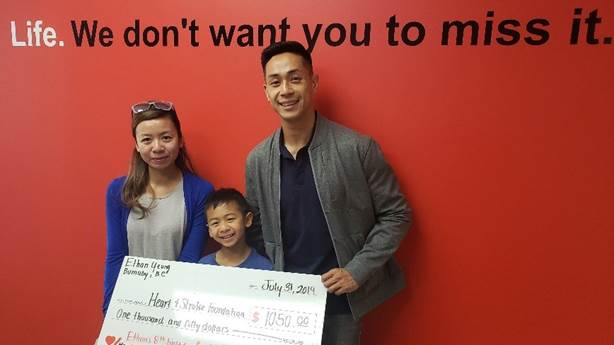 <p>Ethan Yeung and his parents presenting Heart &amp; Stroke with the money he raised.</p>