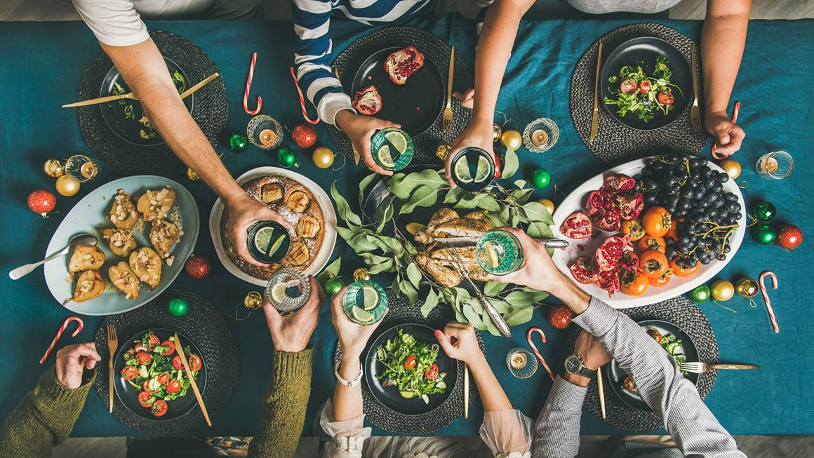 Friends or family celebrating a healthy holiday dinner together