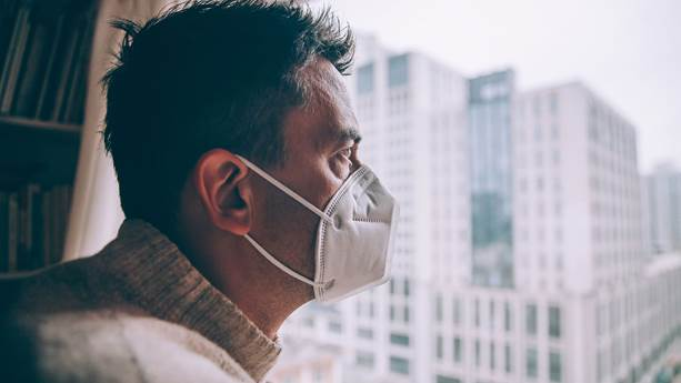 A man staying at home and wearing a mask during the coronavirus outbreak.