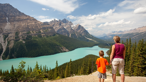 A mother and child admiring the mountain view.