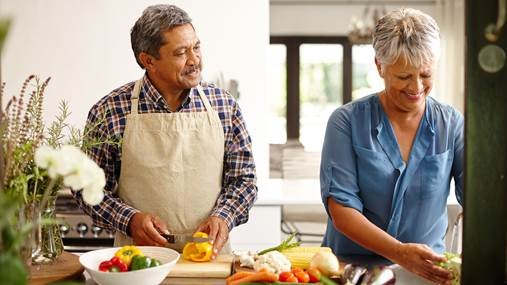 Shot of a happy senior couple cooking a healthy meal together at home