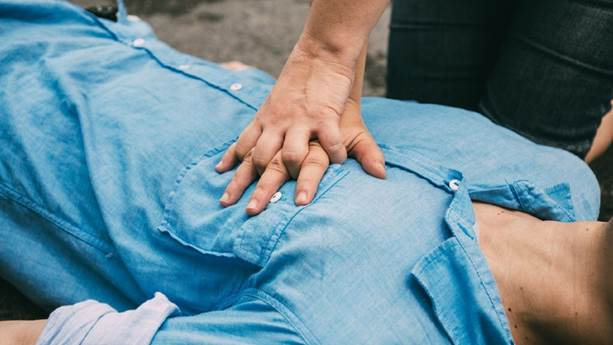 Hands doing CPR on a man's chest