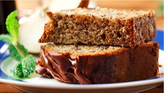 slices of banana bread with chocolate icing on plate