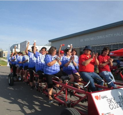 Members of the Sky family wear matching blue and white Tshirts as they ride the Heart  Stroke Big Bi