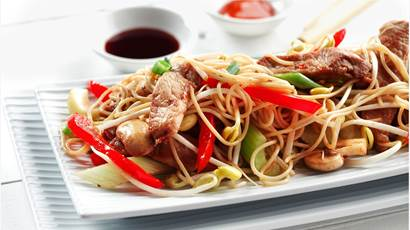 Sliced pork, noodles, red peppers, scallions and mushrooms