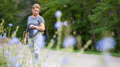 Woman exercising outdoors checking her fitness monitor