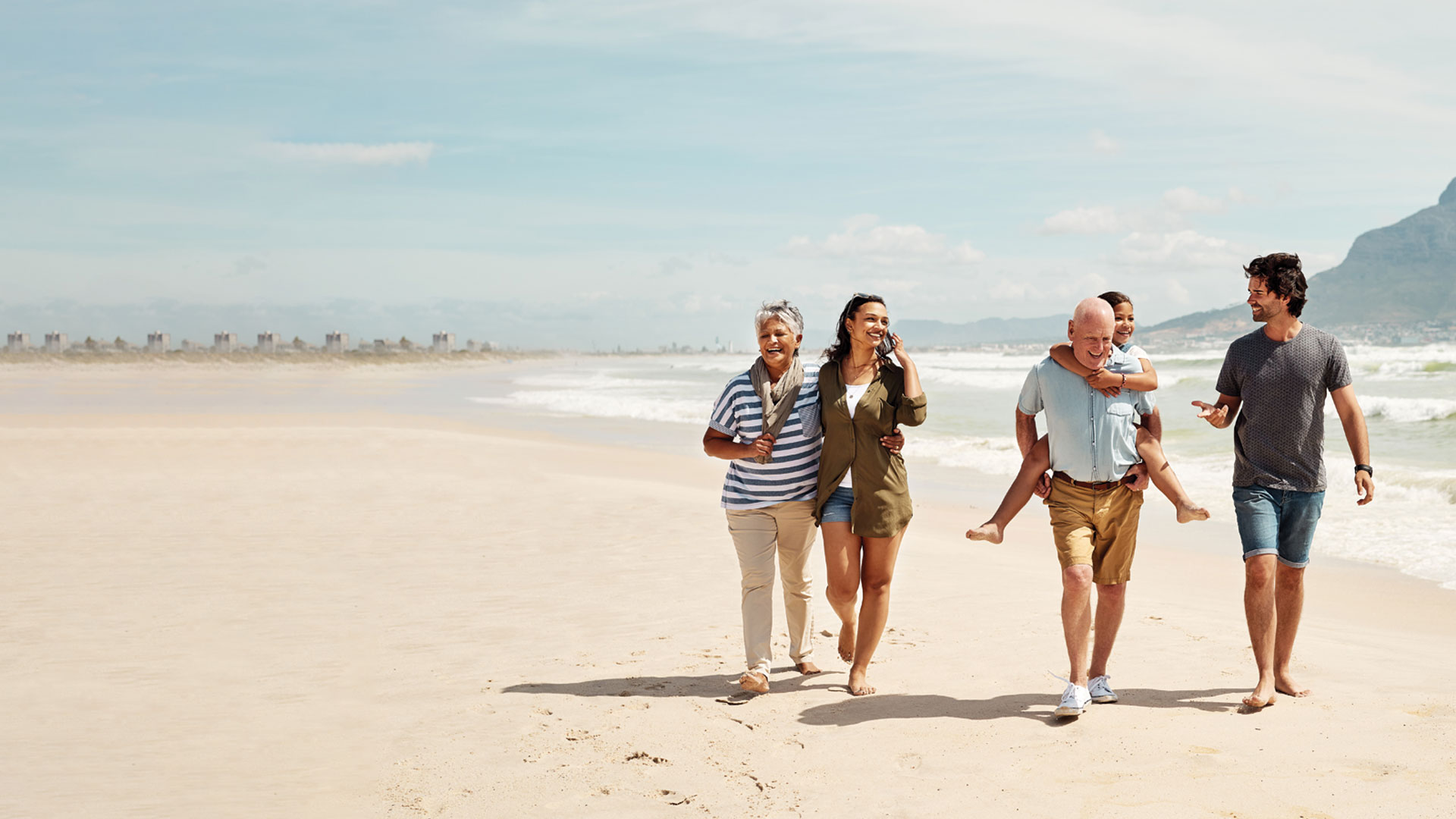 Family walking and laughing on a beach
