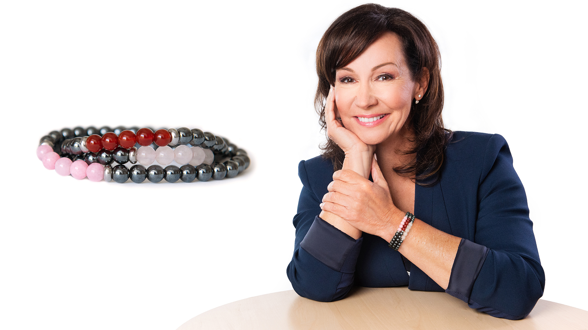 Josee Boudreault headshot with a jewel of life bracelets.