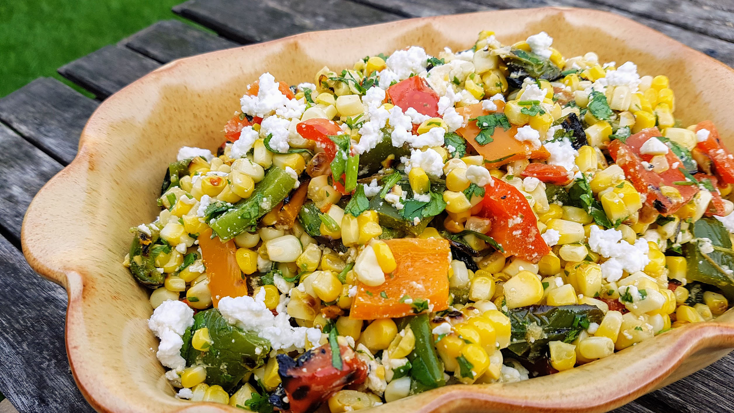 Grilled corn and pepper salad in bowl
