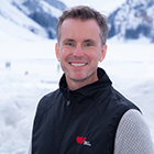 Adam Kirton in front of a snow covered mountain