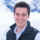 Thomas Cherney in front of a snow covered mountain.
