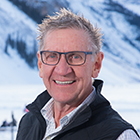 Jim Pangle in front of a snow covered mountain.