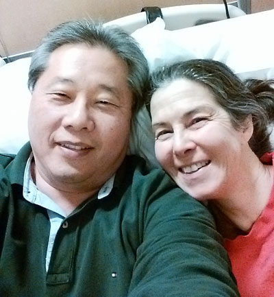Barry and Donna take a selfie on a hospital bed